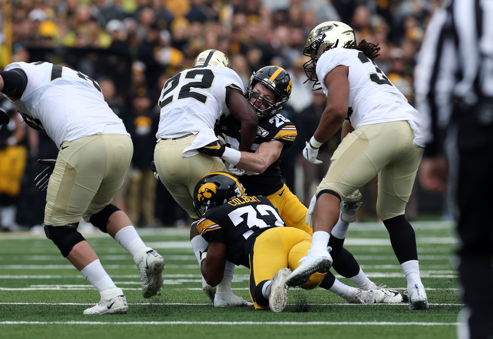 Iowa Hawkeyes defensive back Jack Koerner (28) and linebacker Djimon Colbert (32) against the Purdue Boilermakers Saturday, October 19, 2019 at Kinnick Stadium. (Brian Ray/hawkeyesports.com)