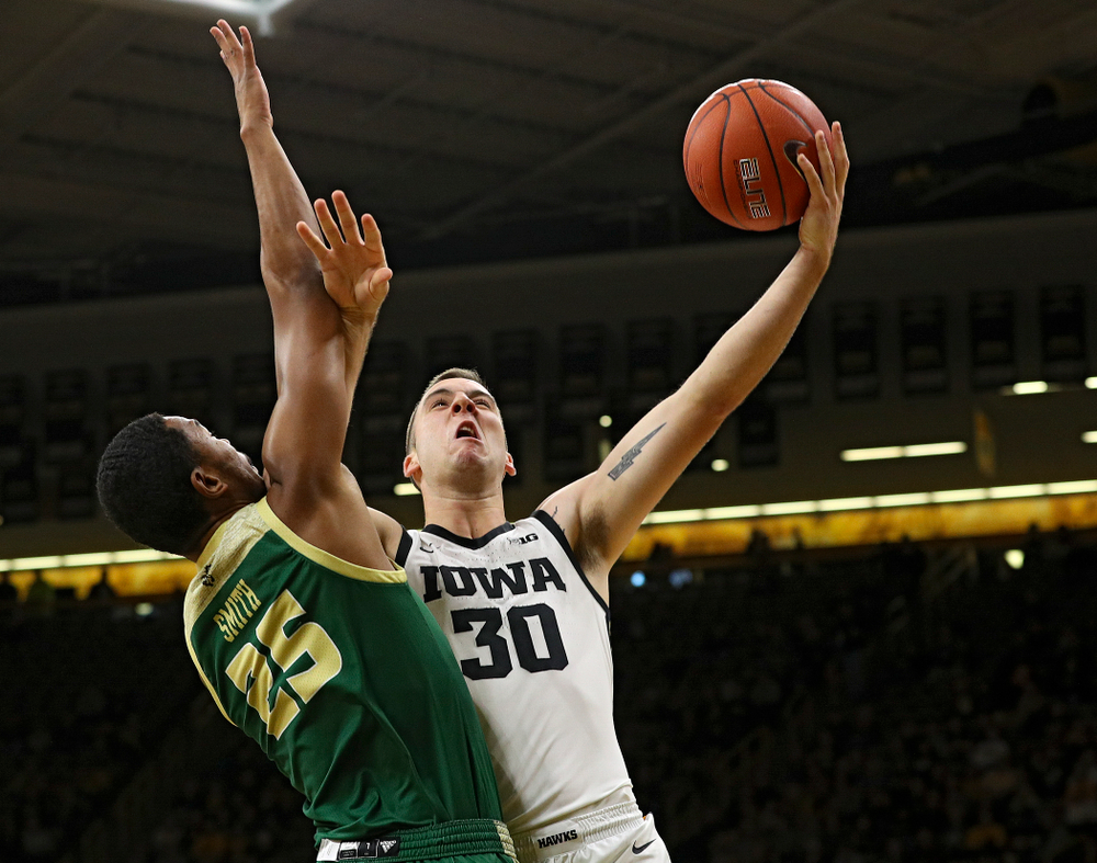 Iowa Hawkeyes guard Connor McCaffery (30) puts up a shot during the first half of their game at Carver-Hawkeye Arena in Iowa City on Sunday, Nov 24, 2019. (Stephen Mally/hawkeyesports.com)