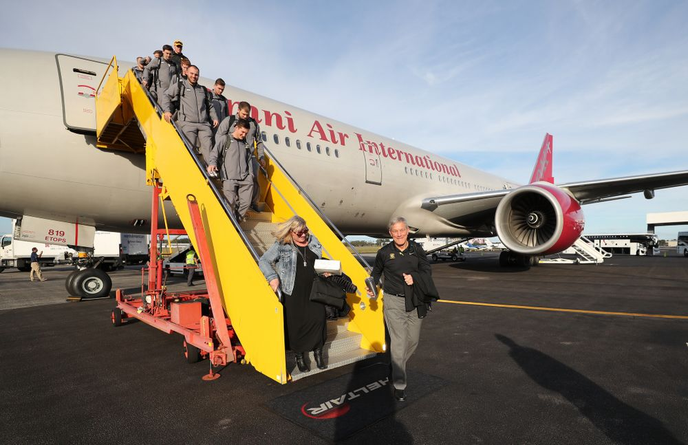 Iowa Hawkeyes head coach Kirk Ferentz and his wife Mary disembark the team plane Wednesday, December 26, 2018 as they arrive in Tampa, Florida for the Outback Bowl. (Brian Ray/hawkeyesports.com)