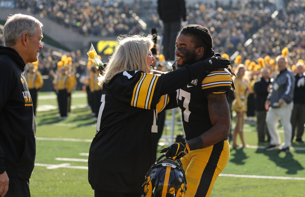Iowa Hawkeyes defensive back Devonte Young (17) and Kirk and Mary Ferentz during Senior Day festivities before their game against the Illinois Fighting Illini Saturday, November 23, 2019 at Kinnick Stadium. (Brian Ray/hawkeyesports.com)