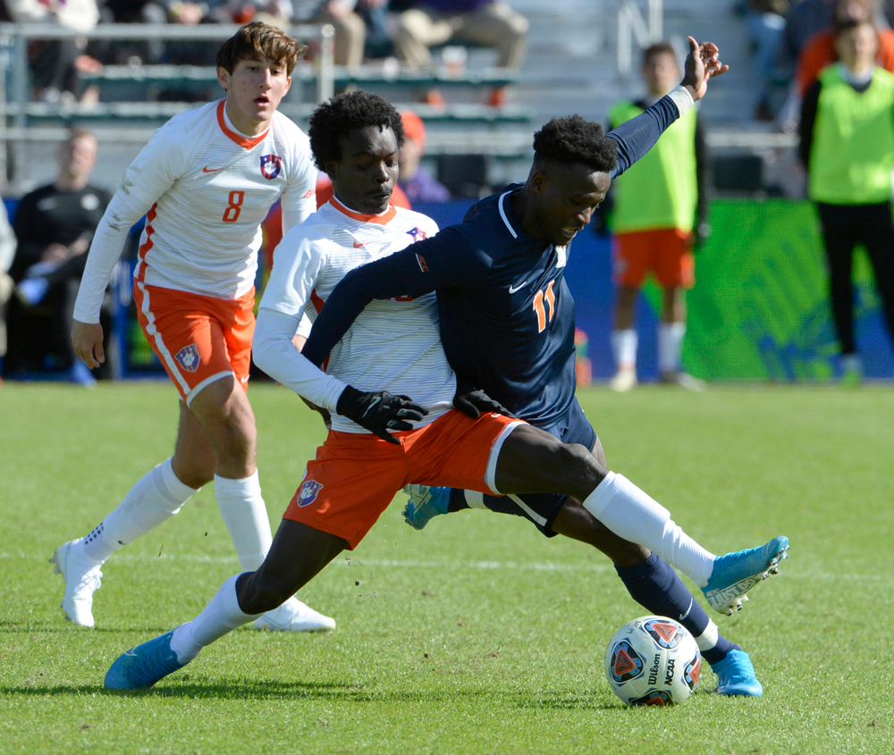 Clemson's Philip Mayaka (20) and Virginia's Irakoze Donasiyano (11) battle for the ball during the 2019 ACC Men?s Soccer Championship at WakeMed Soccer Park in Cary, N.C., Sunday Nov. 17, 2019. (Photo by Sara D. Davis, the ACC)
