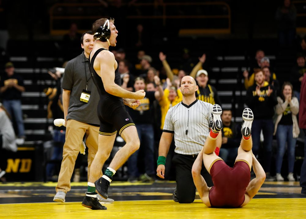 Iowa's Carter Happel celebrates after pinning  Minnesota's #10 Tommy Thorn at 141 pounds