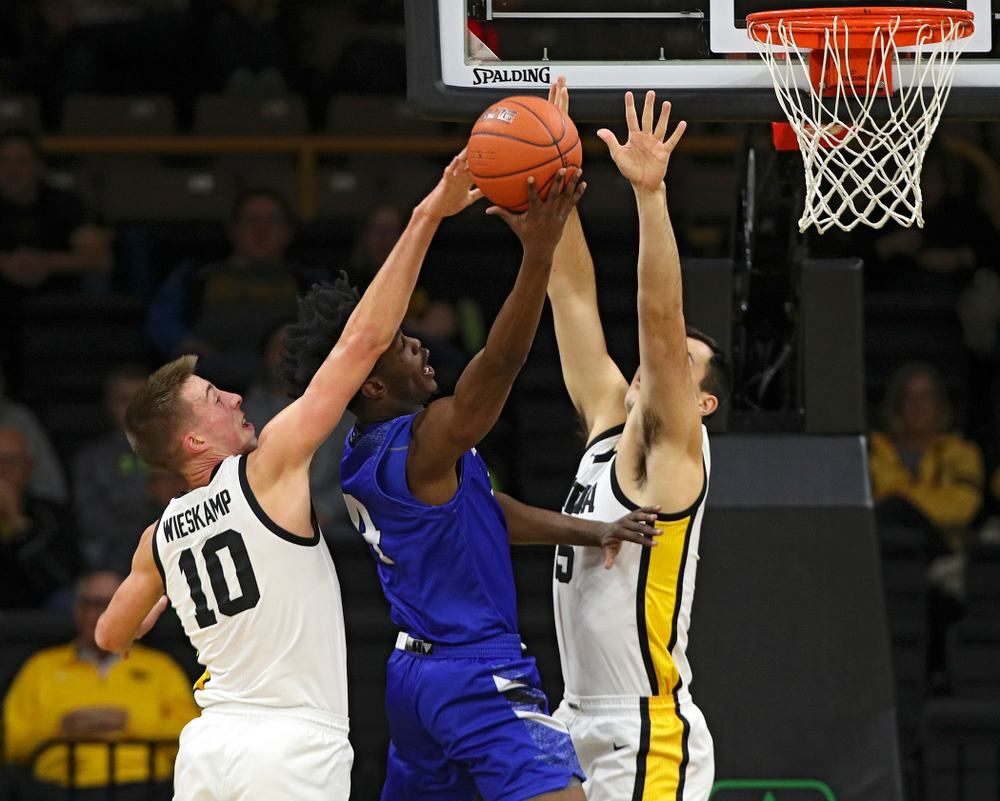 Iowa Hawkeyes guard Joe Wieskamp (10) blocks a shot as guard CJ Fredrick (5) defends during the first half of their exhibition game against Lindsey Wilson College at Carver-Hawkeye Arena in Iowa City on Monday, Nov 4, 2019. (Stephen Mally/hawkeyesports.com)