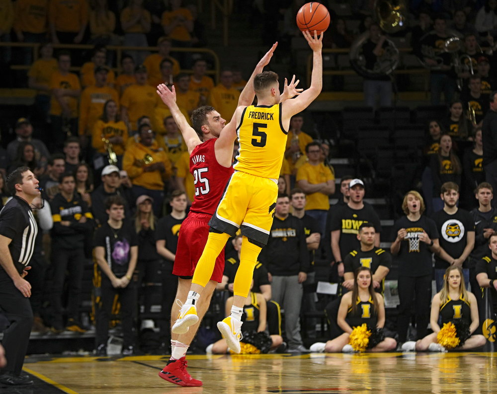 Iowa Hawkeyes guard CJ Fredrick (5) makes a 3-pointer at the end of the first half of their game at Carver-Hawkeye Arena in Iowa City on Saturday, February 8, 2020. (Stephen Mally/hawkeyesports.com)