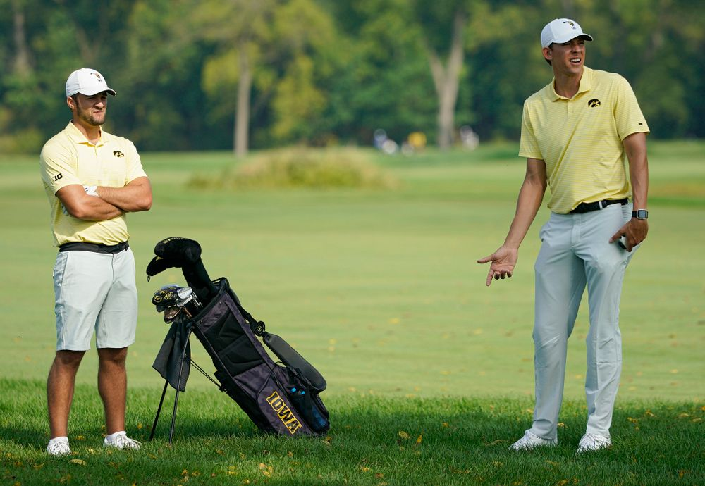 Iowa's Gonzalo Leal (from left) talks with assistant coach Charlie Hoyle during the third day of the Golfweek Conference Challenge at the Cedar Rapids Country Club in Cedar Rapids on Tuesday, Sep 17, 2019. (Stephen Mally/hawkeyesports.com)