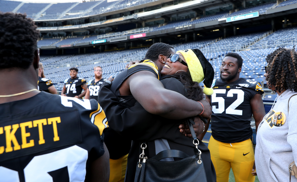 Iowa Hawkeyes defensive tackle Daviyon Nixon (54) following the team photo Wednesday, December 25, 2019 at SDCCU Stadium in San Diego. (Brian Ray/hawkeyesports.com)
