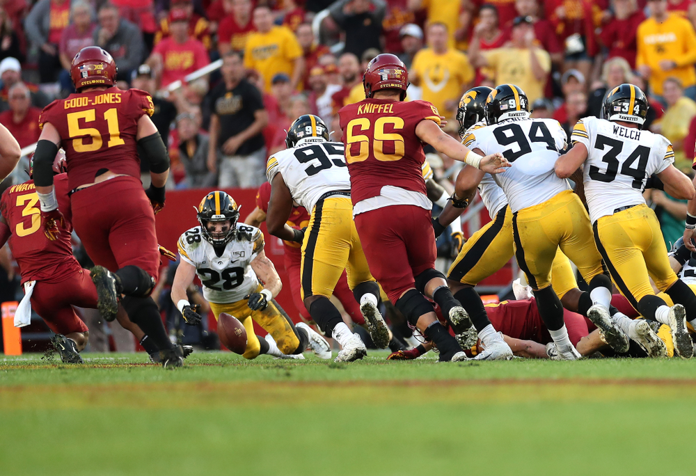 Iowa Hawkeyes defensive back Jack Koerner (28) recovers a fumble against the Iowa State Cyclones Saturday, September 14, 2019 in Ames, Iowa. (Brian Ray/hawkeyesports.com)