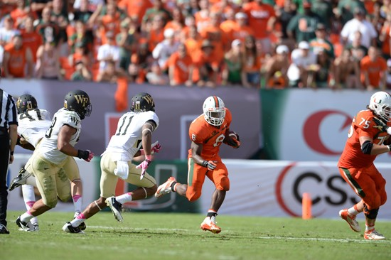 University of Miami Hurricanes running back Duke Johnson #8 carried the ball 30 times for 169 yards and scored two touchdowns in a game against the...