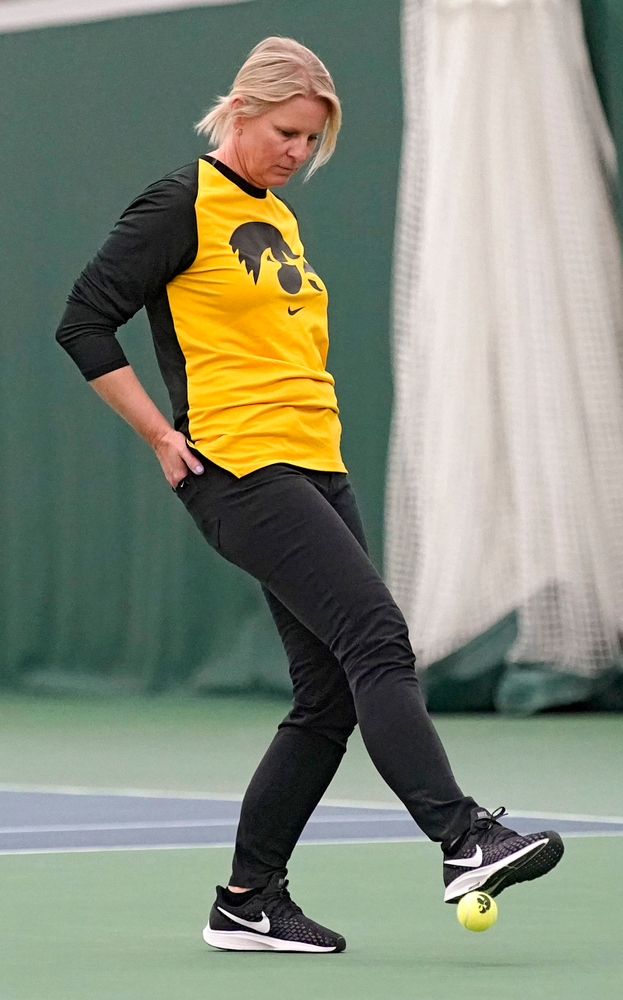 Iowa head coach Sasha Schmid stops a ball during their match against Indiana at the Hawkeye Tennis and Recreation Complex in Iowa City on Sunday, Mar. 31, 2019. (Stephen Mally/hawkeyesports.com)