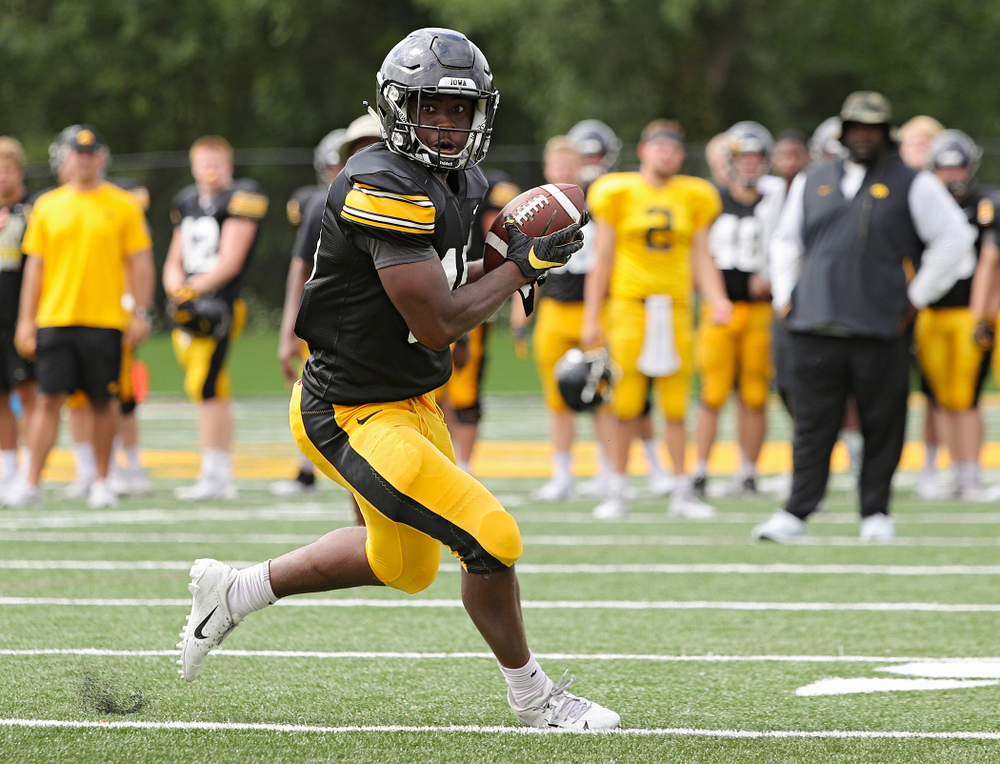 Iowa Hawkeyes running back Tyler Goodson (15) runs after pulling in a pass during Fall Camp Practice No. 10 at the Hansen Football Performance Center in Iowa City on Tuesday, Aug 13, 2019. (Stephen Mally/hawkeyesports.com)