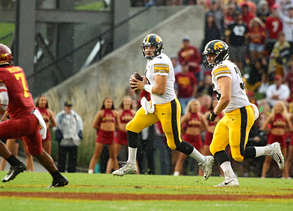 Iowa Hawkeyes quarterback Nate Stanley (4) looks to throw as he rolls out while fullback Brady Ross (36) looks on during the first quarter of their Iowa Corn Cy-Hawk Series game at Jack Trice Stadium in Ames on Saturday, Sep 14, 2019. (Stephen Mally/hawkeyesports.com)