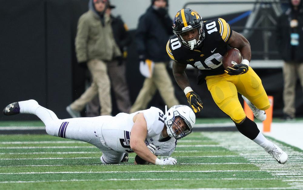 Iowa Hawkeyes running back Mekhi Sargent (10) breaks a tackle during a game against Northwestern at Kinnick Stadium on November 10, 2018. (Tork Mason/hawkeyesports.com)