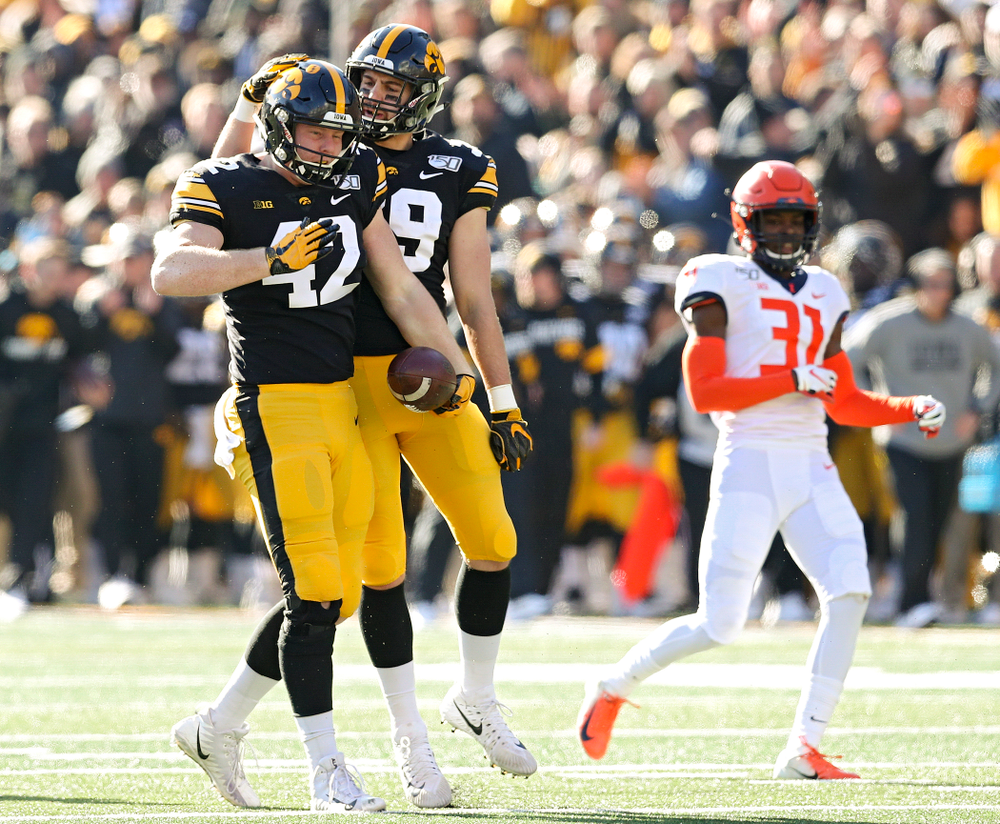 Iowa Hawkeyes tight end Shaun Beyer (42) celebrates with tight end Nate Wieting (39) after Beyer pulled in a pass during the second quarter of their game at Kinnick Stadium in Iowa City on Saturday, Nov 23, 2019. (Stephen Mally/hawkeyesports.com)