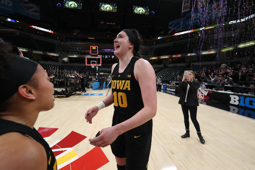 Iowa Hawkeyes forward Megan Gustafson (10) celebrates their win against the Maryland Terrapins Sunday, March 10, 2019 at Bankers Life Fieldhouse in Indianapolis, Ind. (Brian Ray/hawkeyesports.com)