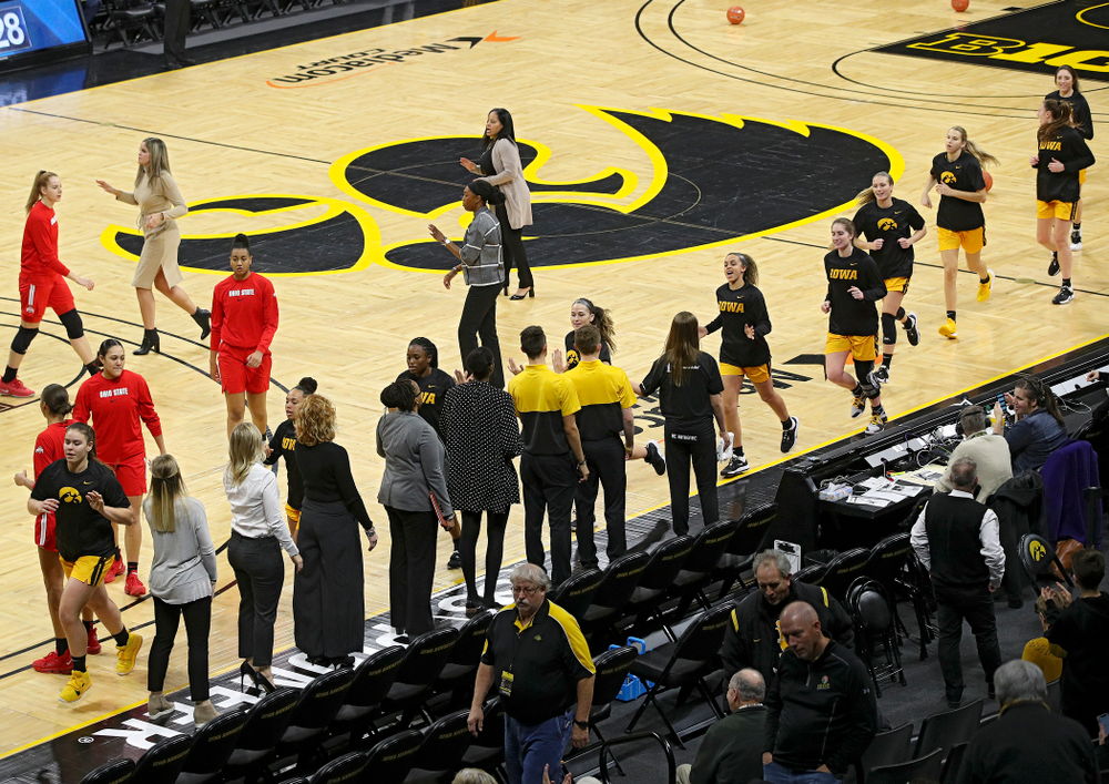 The Hawkeyes run off the court after warming up before their game at Carver-Hawkeye Arena in Iowa City on Thursday, January 23, 2020. (Stephen Mally/hawkeyesports.com)