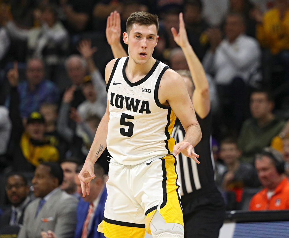 Iowa Hawkeyes guard CJ Fredrick (5) celebrates after making a 3-pointer during the first quarter of the game at Carver-Hawkeye Arena in Iowa City on Sunday, February 2, 2020. (Stephen Mally/hawkeyesports.com)