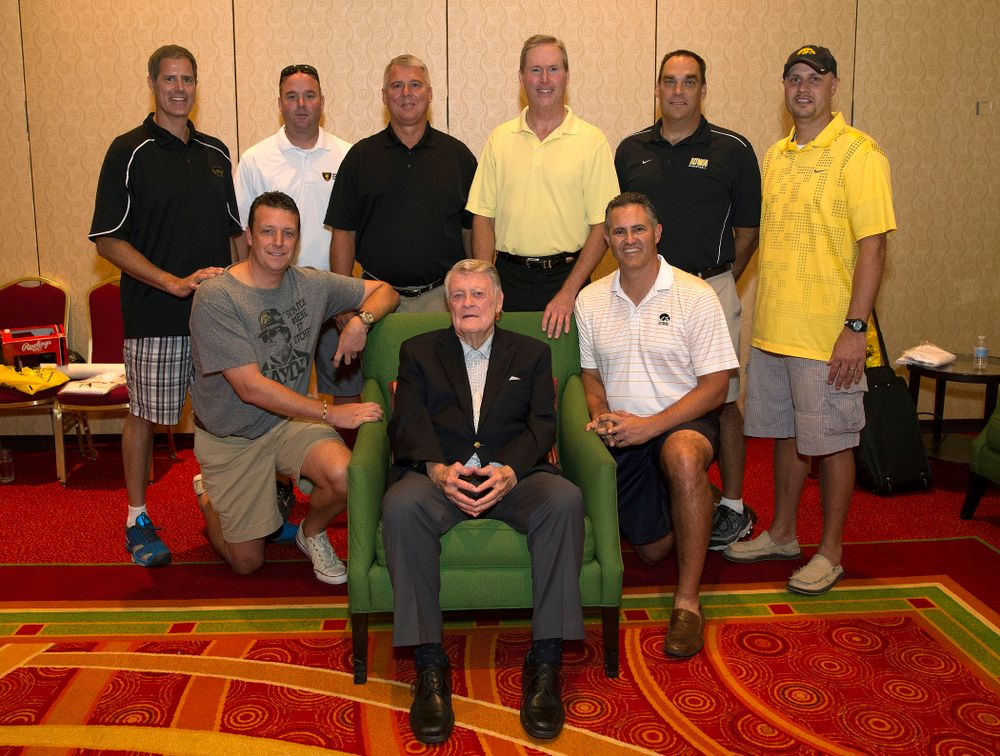 Former Hawkeye Football Head Coach Hayden Fry poses with some of his former quarterbacks before a panel discussion during Fry Fest Friday, Aug. 29, 2014 in Coralville.  (Brian Ray/hawkeyesports.com)