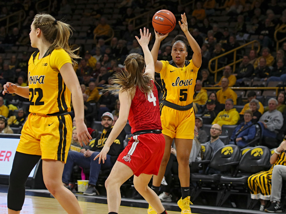 Iowa Hawkeyes guard Alexis Sevillian (5) makes a 3-pointer during the first quarter of their game at Carver-Hawkeye Arena in Iowa City on Thursday, January 23, 2020. (Stephen Mally/hawkeyesports.com)