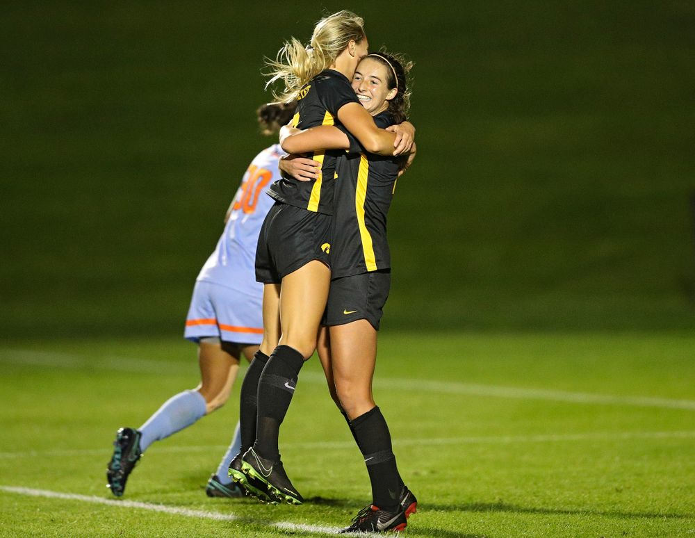 Iowa midfielder Hailey Rydberg (2) jumps into the arms of forward Kaleigh Haus (4) after Haus scored a goal during the second half of their match against Illinois at the Iowa Soccer Complex in Iowa City on Thursday, Sep 26, 2019. (Stephen Mally/hawkeyesports.com)