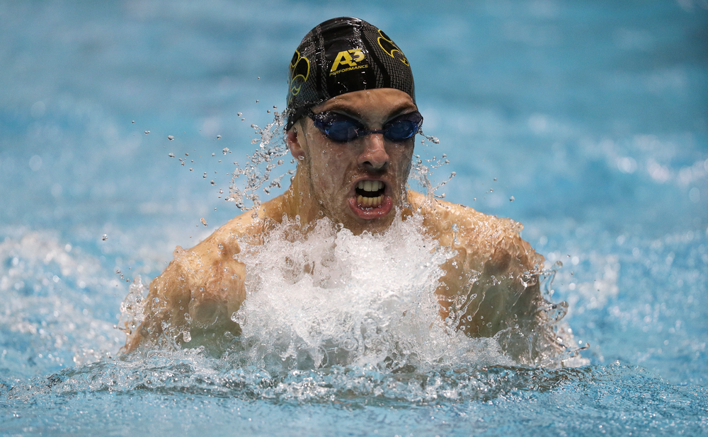 Iowa's Weston Credit competes in the 100-yard breaststroke during the third day of the Hawkeye Invitational at the Campus Recreation and Wellness Center on November 16, 2018. (Tork Mason/hawkeyesports.com)