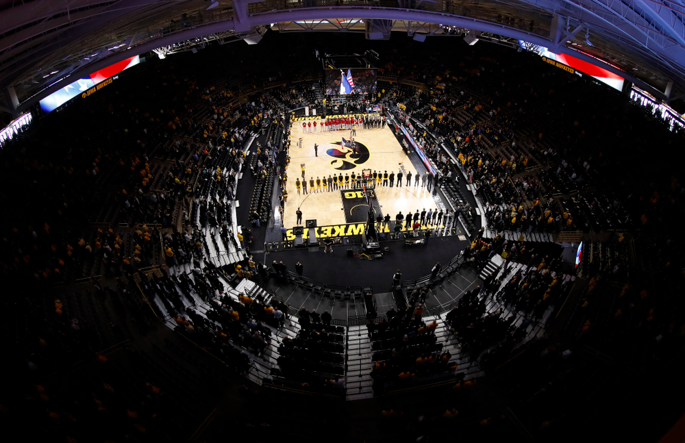 The Iowa Hawkeyes stand for the National Anthem before their game