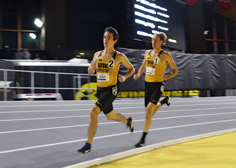 Iowa's Noah Healy (from left) and Jeff Roberts run the men's 1 mile run event during the Jimmy Grant Invitational at the Recreation Building in Iowa City on Saturday, December 14, 2019. (Stephen Mally/hawkeyesports.com)