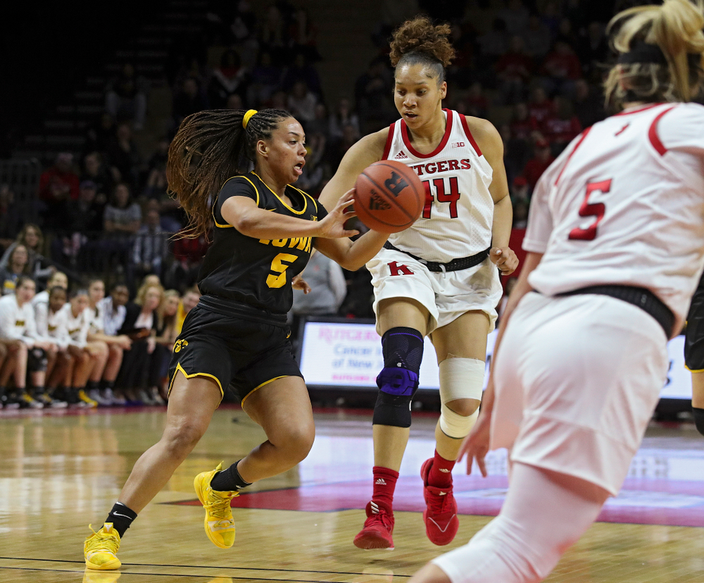 Iowa guard Alexis Sevillian (5) passes the ball during the first quarter of their game at the Rutgers Athletic Center in Piscataway, N.J. on Sunday, March 1, 2020. (Stephen Mally/hawkeyesports.com)