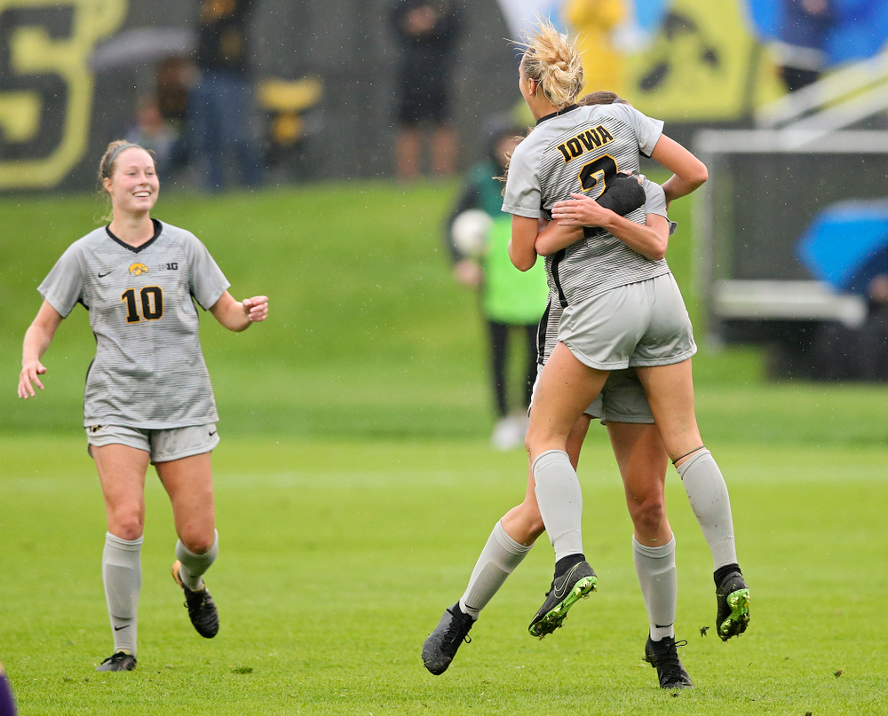 Iowa midfielder Hailey Rydberg (2) jumps into the arms of midfielder Josie Durr (25) after Rydberg scored a goal during the first half of their match at the Iowa Soccer Complex in Iowa City on Sunday, Sep 29, 2019. (Stephen Mally/hawkeyesports.com)
