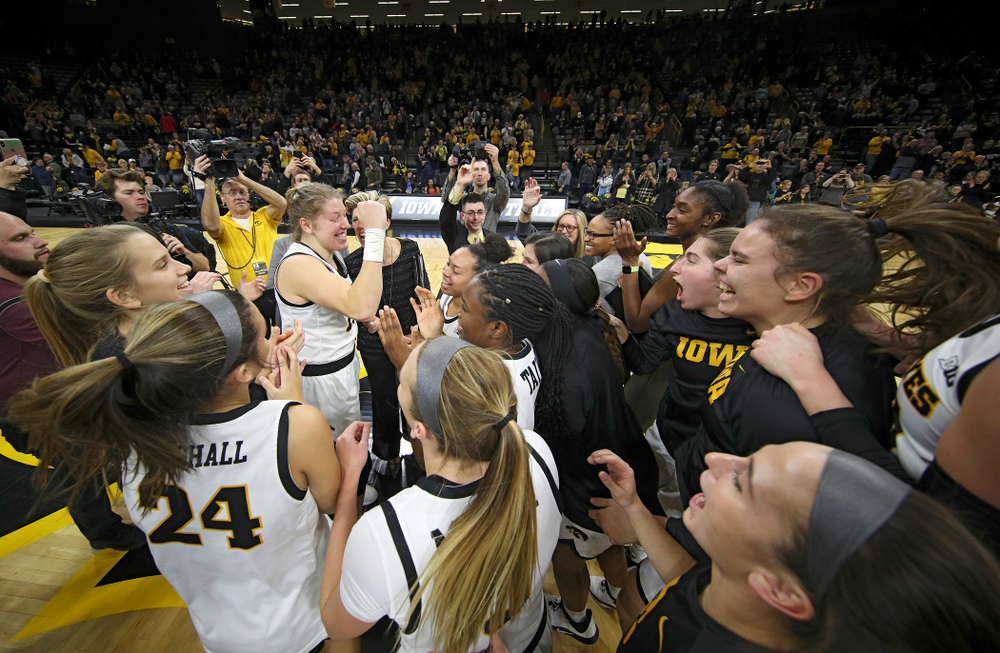 The Hawkeyes huddle after their double overtime win at Carver-Hawkeye Arena in Iowa City on Sunday, January 12, 2020. (Stephen Mally/hawkeyesports.com)