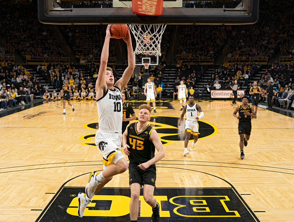 Iowa Hawkeyes guard Joe Wieskamp (10) dunks the ball during the second half of their their game at Carver-Hawkeye Arena in Iowa City on Sunday, December 29, 2019. (Stephen Mally/hawkeyesports.com)