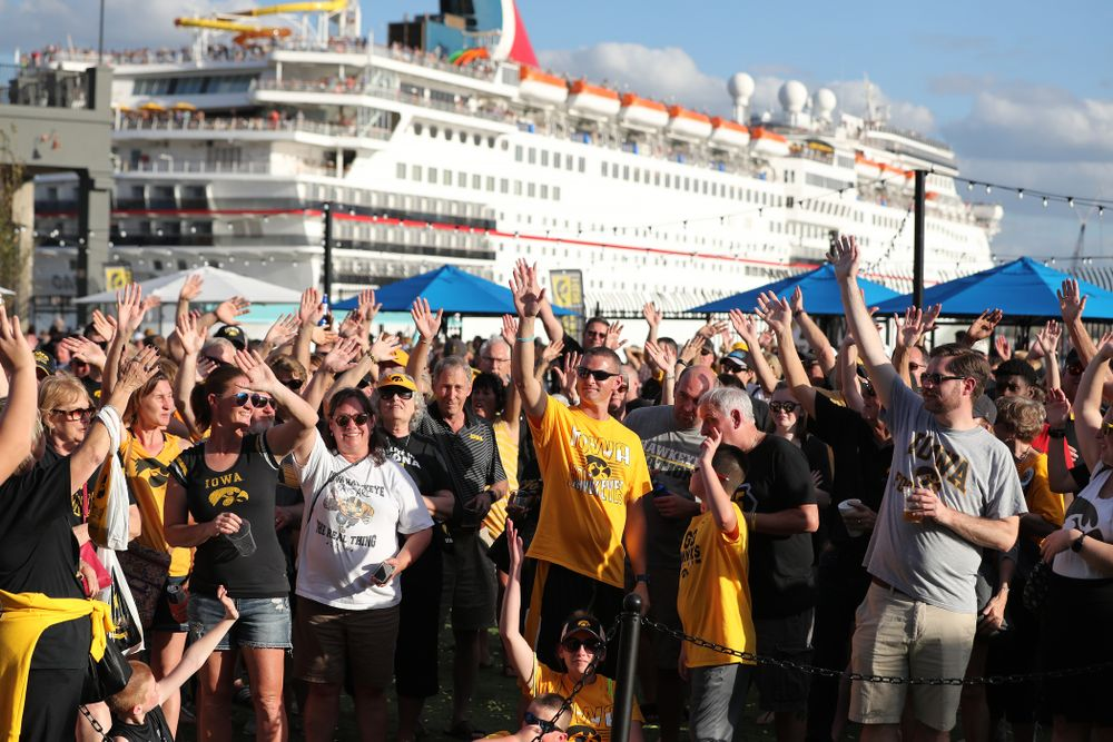 Fans wave to the folks back in Iowa during their Hawkeye Huddle Monday, December 31, 2018 at Sparkman Wharf in Tampa, FL. (Brian Ray/hawkeyesports.com)