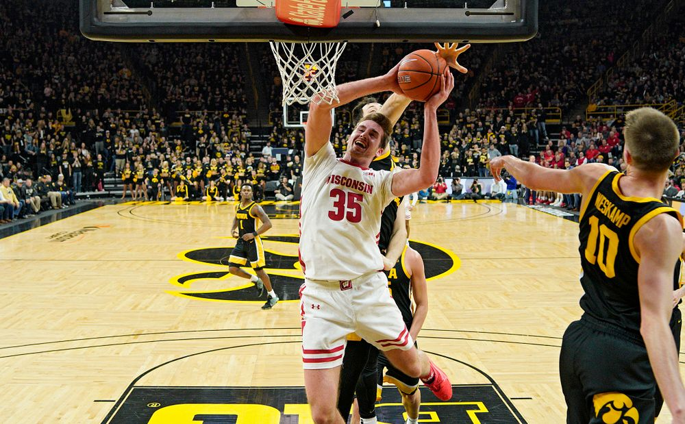 Iowa Hawkeyes forward Ryan Kriener (15) blocks a shot by Wisconsin Badgers forward Nate Reuvers (35) during the first half of their game at Carver-Hawkeye Arena in Iowa City on Monday, January 27, 2020. (Stephen Mally/hawkeyesports.com)