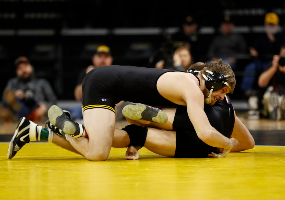 Iowa's Mitch Bowman wrestles Northwestern's Mitch Sliga at 184 pounds