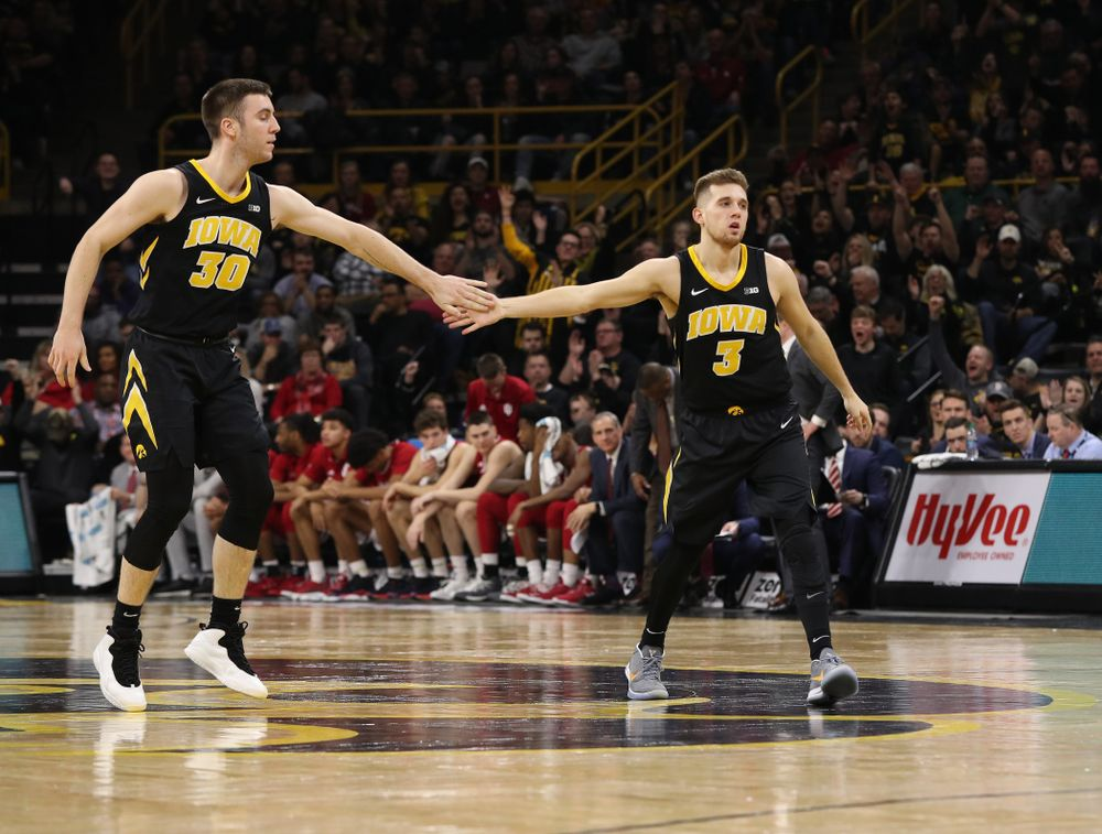 Iowa Hawkeyes guard Jordan Bohannon (3) and guard Connor McCaffery (30) against the Indiana Hoosiers Friday, February 22, 2019 at Carver-Hawkeye Arena. (Brian Ray/hawkeyesports.com)