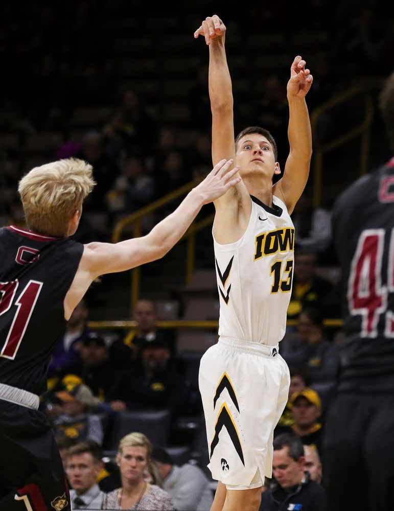 Iowa Hawkeyes guard Austin Ash (13) puts up a 3-pointer during a game against Guilford College at Carver-Hawkeye Arena on November 4, 2018. (Tork Mason/hawkeyesports.com)