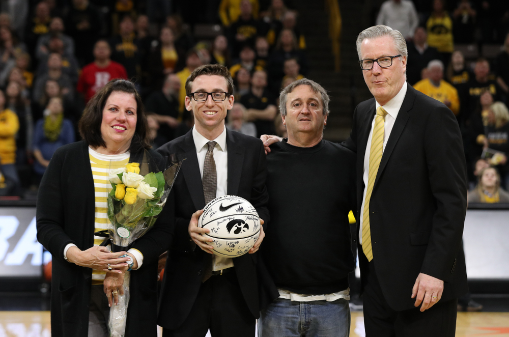 Senior Manager Brendan O'Connor stands with Iowa Hawkeyes head coach Fran McCaffery and his family during senior day activities before their game against the Rutgers Scarlet Knights  Saturday, March 2, 2019 at Carver-Hawkeye Arena. (Brian Ray/hawkeyesports.com)