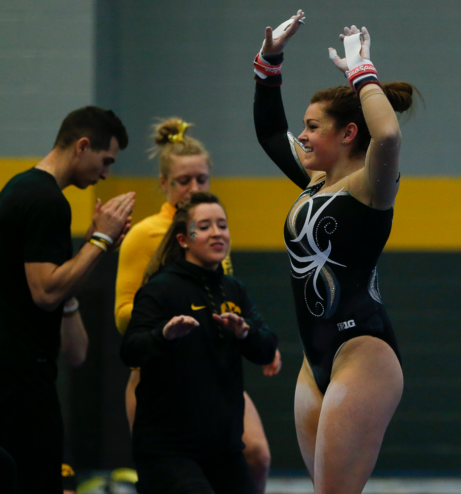 Erin Castle celebrates after competing on the uneven bars during the Black and Gold Intrasquad meet at the Field House on 12/2/17. (Tork Mason/hawkeyesports.com)