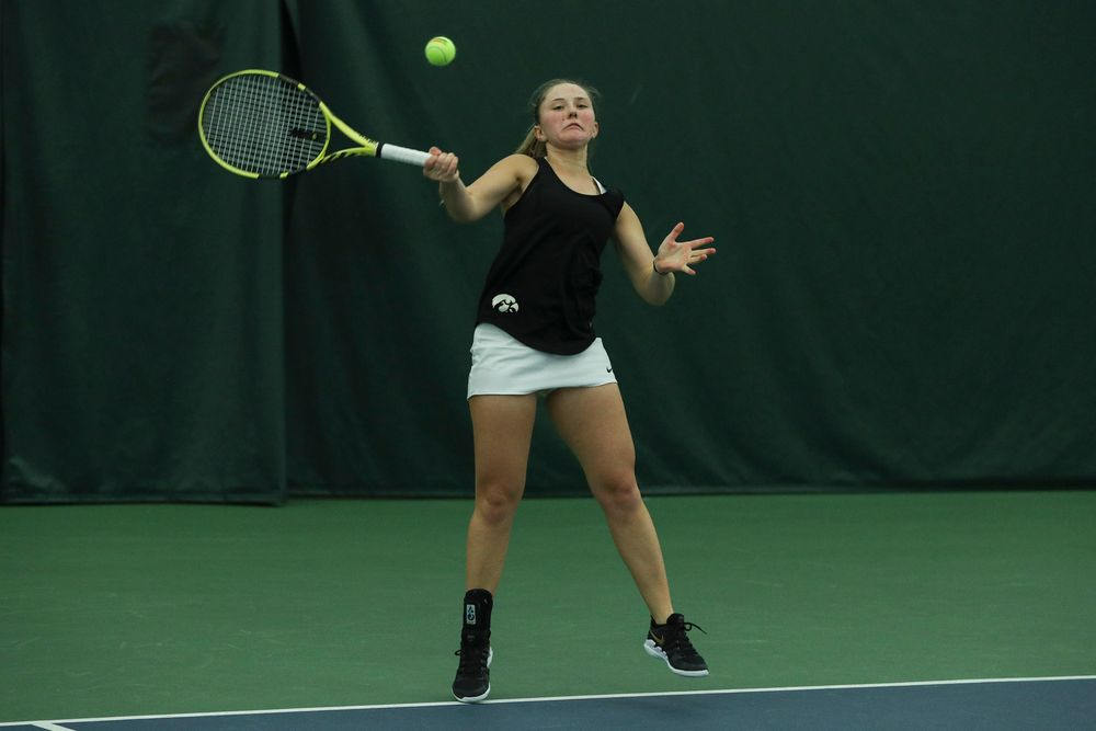 Iowa's Danielle Burich returns a hit during the Iowa women's tennis meet vs DePaul  on Friday, February 21, 2020 at the Hawkeye Tennis and Recreation Complex. (Lily Smith/hawkeyesports.com)