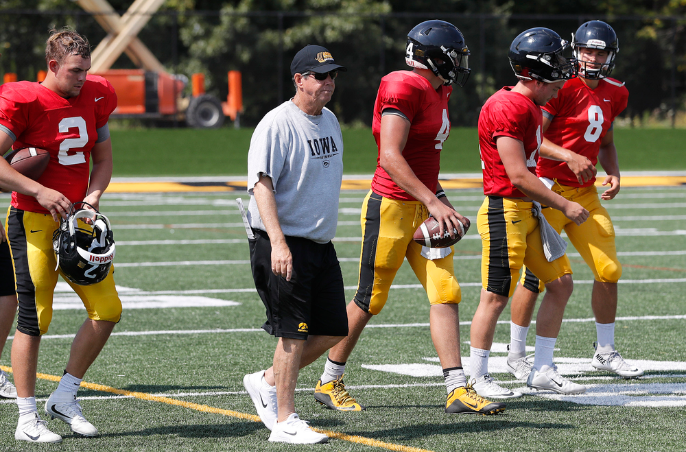 Quarterbacks coach Ken O'Keefe and the Hawkeye quarterbacks
