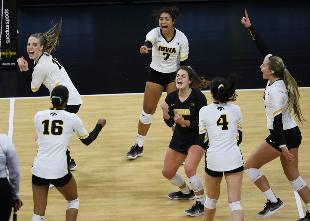 Iowa Hawkeyes middle blocker Hannah Clayton (18), Iowa Hawkeyes setter Brie Orr (7) and Iowa Hawkeyes defensive specialist Molly Kelly (1) celebrate after winning a point during a match against Penn State at Carver-Hawkeye Arena on November 3, 2018. (Tork Mason/hawkeyesports.com)