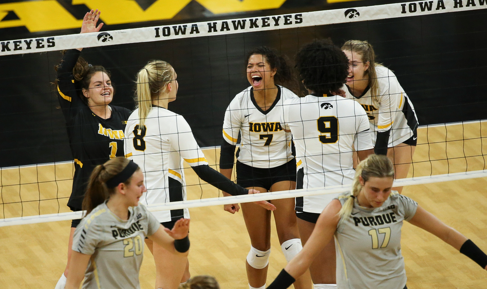 Iowa Hawkeyes defensive specialist Molly Kelly (1) and Iowa Hawkeyes setter Brie Orr (7) react after winning a point during a game against Purdue at Carver-Hawkeye Arena on October 13, 2018. (Tork Mason/hawkeyesports.com)