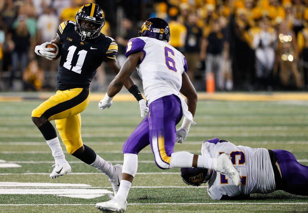 Iowa Hawkeyes defensive back Michael Ojemudia (11) returns an interception during a game against Northern Iowa at Kinnick Stadium on September 15, 2018. (Tork Mason/hawkeyesports.com)