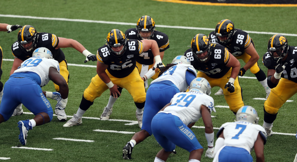 Iowa Hawkeyes offensive lineman Cole Banwart (61), offensive lineman Tyler Linderbaum (65), offensive lineman Landan Paulsen (68), and offensive lineman Tristan Wirfs (74) against Middle Tennessee State Saturday, September 28, 2019 at Kinnick Stadium. (Brian Ray/hawkeyesports.com)