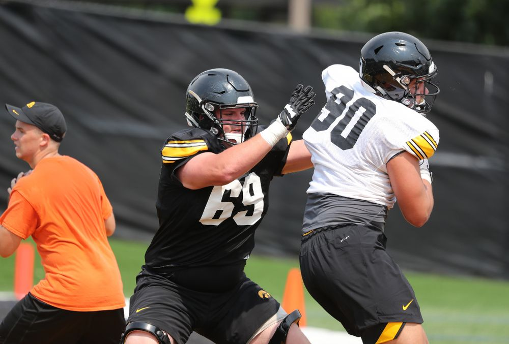Iowa Hawkeyes offensive lineman Keegan Render (69) against defensive end Sam Brincks (90) during the third practice of fall camp Sunday, August 5, 2018 at the Kenyon Football Practice Facility. (Brian Ray/hawkeyesports.com)
