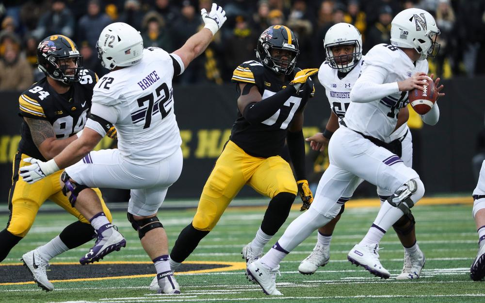 Iowa Hawkeyes defensive end Chauncey Golston (57) rushes the quarterback during a game against Northwestern at Kinnick Stadium on November 10, 2018. (Tork Mason/hawkeyesports.com)