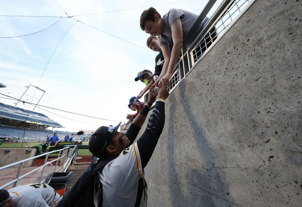 Iowa Hawkeyes Izaya Fullard (20) signs autographs following their game against the Indiana Hoosiers in the first round of the Big Ten Baseball Tournament Wednesday, May 22, 2019 at TD Ameritrade Park in Omaha, Neb. (Brian Ray/hawkeyesports.com)