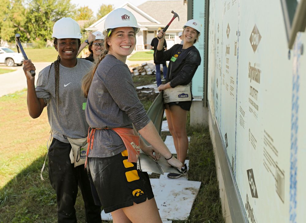 Iowa's Tomi Taiwo (from left), Kathryn Reynolds, director of player development, Kate Martin, and Kathleen Doyle work on a Habitat for Humanity Women Build project in Iowa City on Wednesday, Sep 25, 2019. (Stephen Mally/hawkeyesports.com)