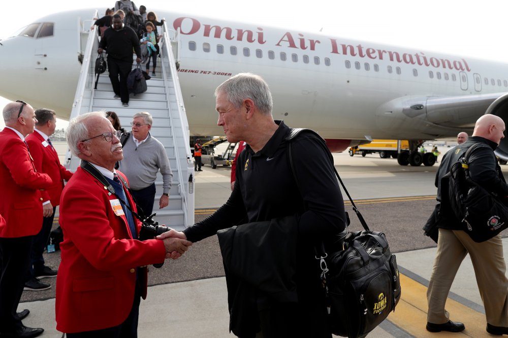 Iowa Hawkeyes head coach Kirk Ferentz shakes hands with the ÒRed CoatsÓ after arriving in San Diego, CA Saturday, December 21, 2019 for the Holiday Bowl. (Brian Ray/hawkeyesports.com)