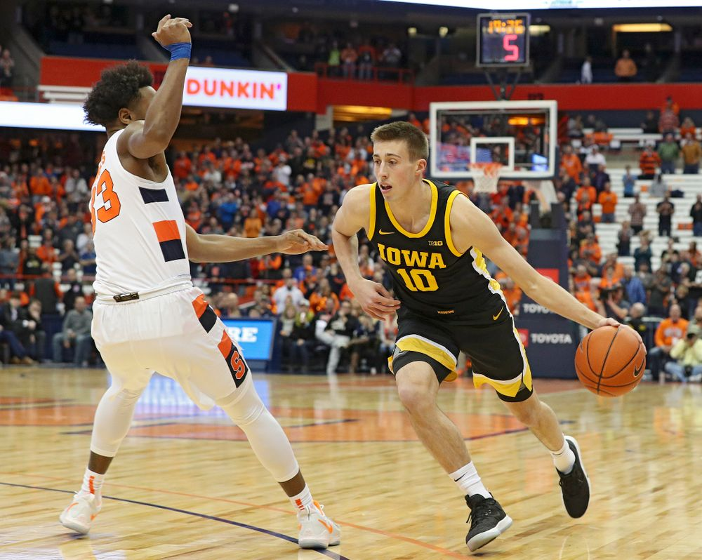 Iowa Hawkeyes forward Riley Till (20) is pumped up after winning their ACC/Big Ten Challenge game at the Carrier Dome in Syracuse, N.Y. on Tuesday, Dec 3, 2019. (Stephen Mally/hawkeyesports.com)