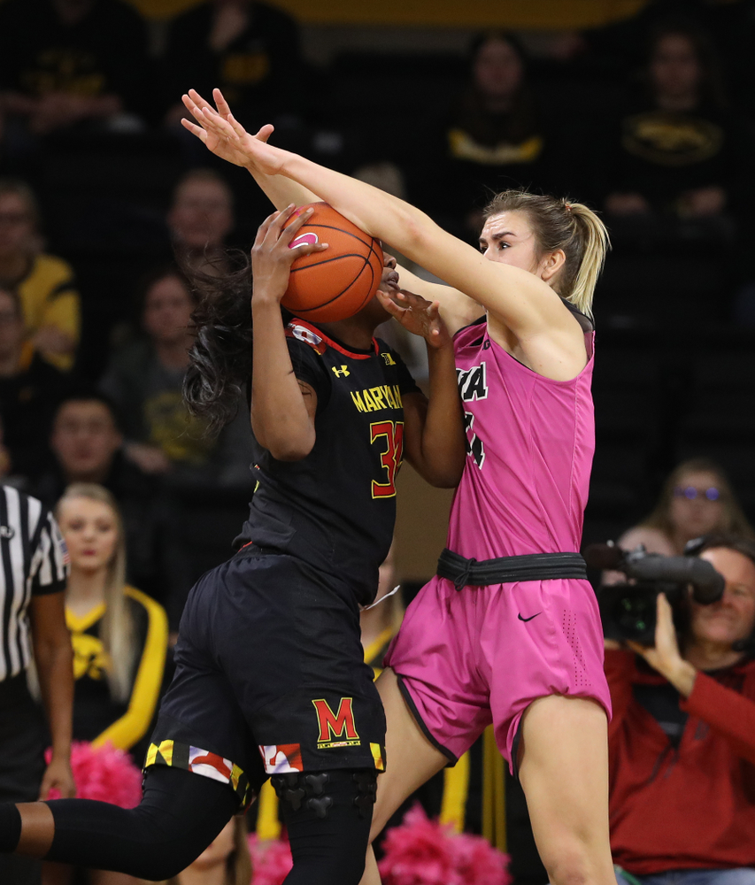 Iowa Hawkeyes forward Hannah Stewart (21) blocks a shot against the seventh ranked Maryland Terrapins Sunday, February 17, 2019 at Carver-Hawkeye Arena. (Brian Ray/hawkeyesports.com)